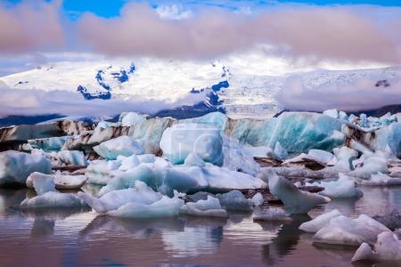 Icebergs and ice floes reflected in water