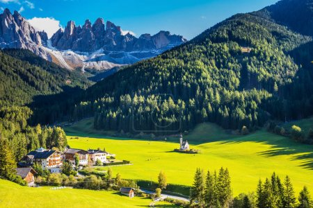 village and church surrounded Alpine meadows