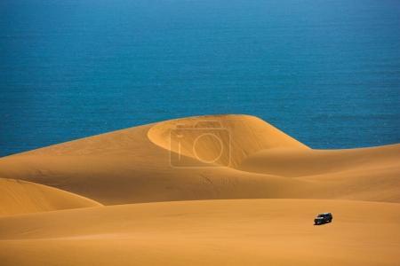 jeep riding through sand dunes