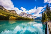 turquoise water in the wooded mountains.