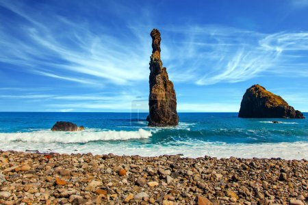 Volcanic fabulous island of Madeira in the Atlantic. Three huge scenic rocks near the pebble beach. Concept of exotic and ecological tourism