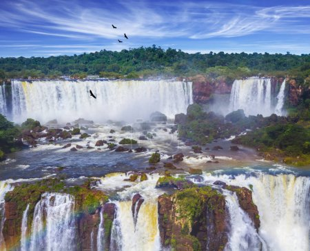 Magnificent waterfall Iguazu Falls in Park. The concept of active and cultural tourism