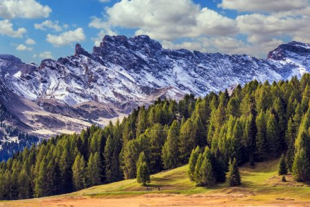 Jagged rocks around the Dolomites mountain valley. The Alps di Siusi. Well-known international ski resort in the fall. Concept of active tourism