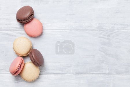 Photo for Sweet colorful macaroons on wooden background - Royalty Free Image