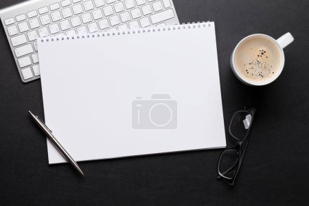 Photo for Office leather desk table with notepad, pc, coffee, pen and glasses close up. Top view with copy space - Royalty Free Image