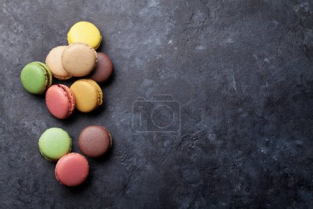Photo for Colorful macaroons on dark stone table - Royalty Free Image