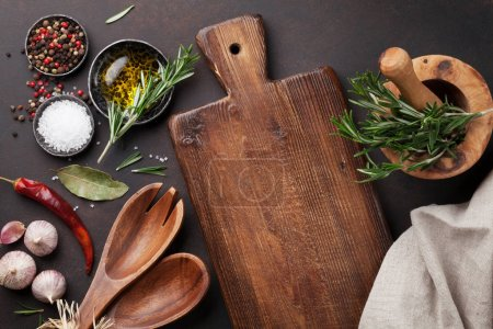 Photo for Cooking table with herbs, spices and utensils - Royalty Free Image