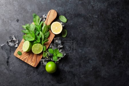 Photo for Mint, lime and ice cubes on stone table - Royalty Free Image