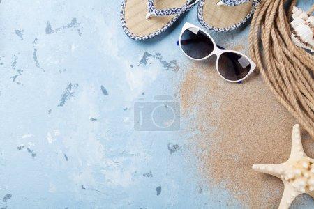 sunglasses, flip-flops and sea shells