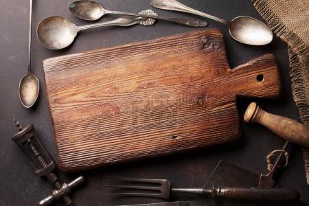 Photo for Old vintage kitchen utensils. Fork, knife, spoons, cutting board. Top view with copy space - Royalty Free Image