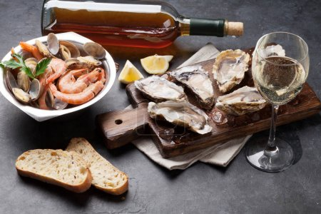 Photo for Fresh seafood and white wine on stone table, top view - Royalty Free Image