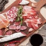 Salami, sliced ham, sausage, prosciutto, bacon, to...