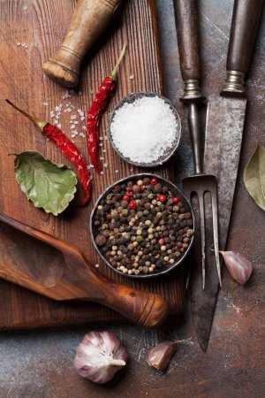 Vintage kitchen utensils and spices over cutting board. Cooking concept. Top view