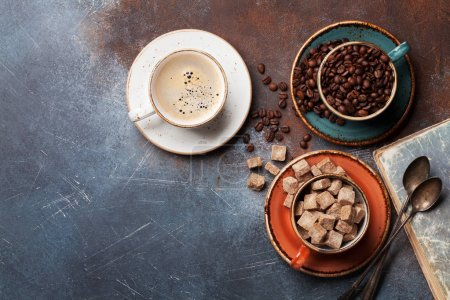 Coffee cups, beans and brown sugar. Top view with space for your text