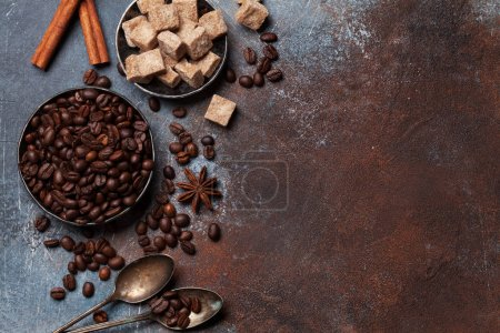 Coffee beans, sugar and spices. Top view with space for your text