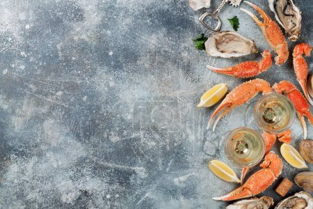 Photo for Seafood. Oysters, lobster, clams and white wine. Top view on stone table with space - Royalty Free Image