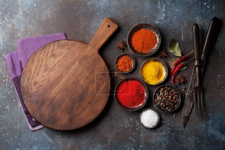 Photo for Colorful spices on stone table and cooking utensils. Top view with space for your recipe - Royalty Free Image