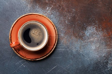 Coffee cup on slate background. Top view with copy space