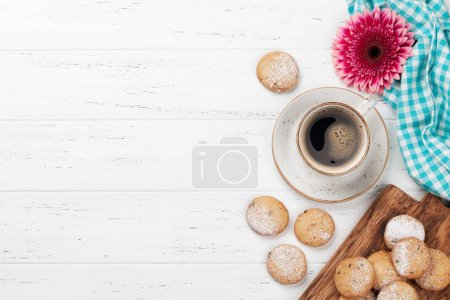 Photo for Cookies and coffee on white wooden table. Top view with space for your text - Royalty Free Image