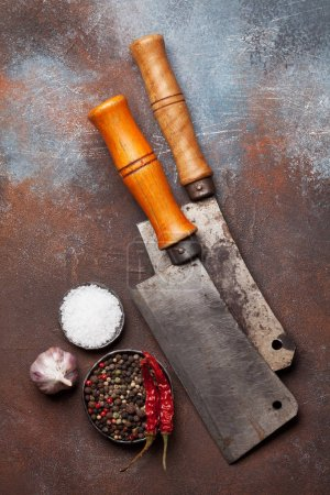 Butcher. Vintage meat knives and spices over metal table. Top view