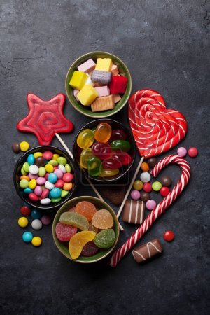 Colorful sweets. Lollipops, macaroons, marshmallow, marmalade and candies. Top view