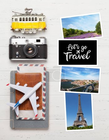 Photo for Travel concept with photos, airplane toy, camera and passport. Top view flat lay with copy space - Royalty Free Image