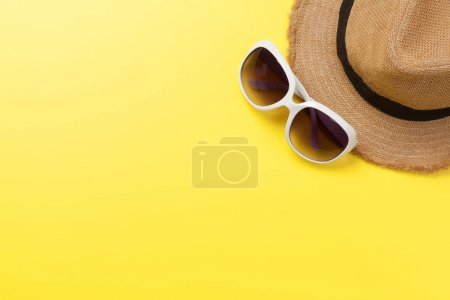 Photo for Travel concept with sun hat and sunglasses. Top view flat lay with copy space - Royalty Free Image