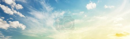 Deep blue sky with scenic clouds. Wide panorama sunset