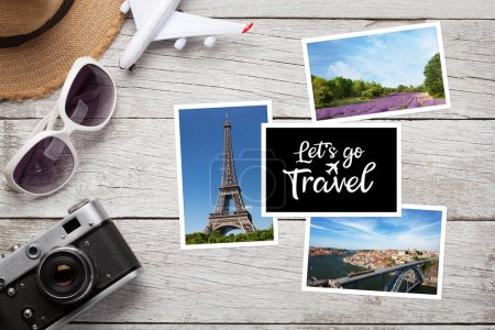 Photo for Travel concept with vacation photos, airplane toy, camera and sunglasses on wooden table. Top view flat lay with copy space - Royalty Free Image