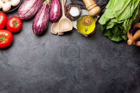 Photo for Cooking utensils and ingredients on stone background. Top view with space for your recipe or menu. Flat lay - Royalty Free Image