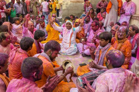 Devotees playing music