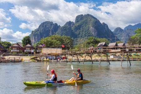 tourists are rowing kayak boats