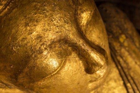 Golden reclining Buddha statue