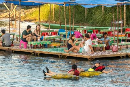 Tourist enjoy tubing in Song River