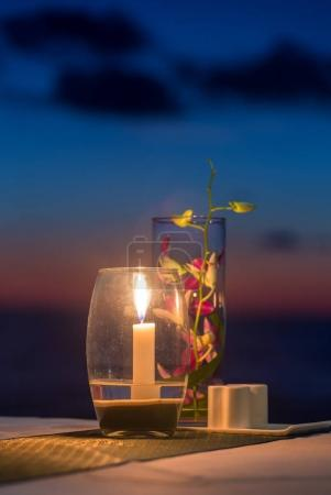 Candle on a table at sunset view restaurant