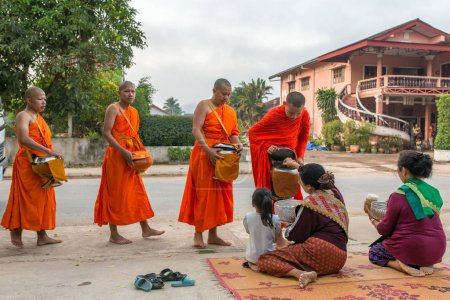Traditional buddhist alms giving ceremony