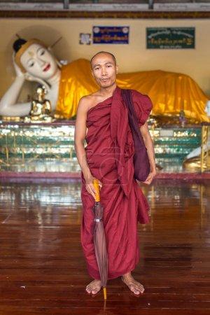 buddhist monk in Shwedagon pagoda in Yangon