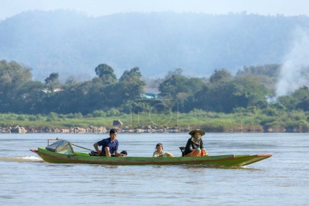 people riding boat on the Mekong river