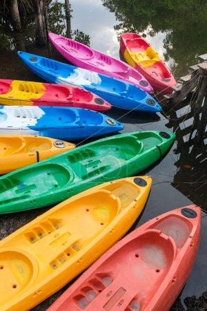 Group of colorful fiberglass kayaks