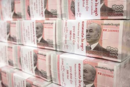 Phnom Penh, Cambodia - March 28, 2017: Stacks of 100 riel banknotes from Cambodia