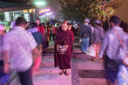 Kyaikhtiyo, Myanmar - October 16, 2016: Buddhist monks collecting alms and offerings on the streets near the Kyaiktiyo pagoda or Golden rock, Myanmar.
