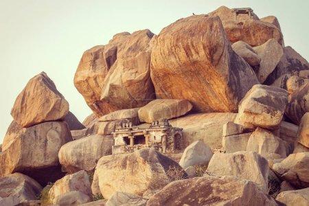 Old temple between stones in Hampi