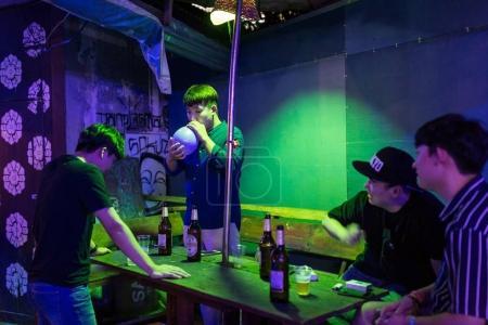 Vang Vieng, Laos - January 21, 2017: Asian tourists having fun in one of the bars in Vang Vieng, Laos