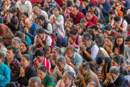 Dharamsala, India - June 6, 2017: The monks and tibetan people listening to his Holiness the 14 Dalai Lama Tenzin Gyatso giving teachings in his residence in Dharamsala, India.