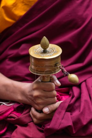 Photo for Tibetan prayer wheel in monks hands close-up - Royalty Free Image