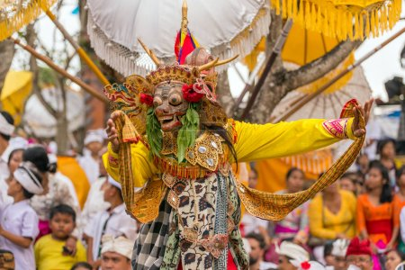 Photo for Bali, Indonesia - September 17, 2016: Balinese man performing in traditional mask during Galungan celebration in Ubud, Bali - Royalty Free Image