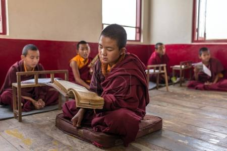 Gangtok, India - May 3, 2017: Lesson for novice monks in buddhist Tsuglakhang monastery in Gangtok, India