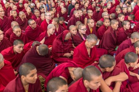 Photo for Dharamsala, India - June 6, 2017: The monks and tibetan people listening to his Holiness the 14 Dalai Lama Tenzin Gyatso giving teachings in his residence in Dharamsala, India. - Royalty Free Image
