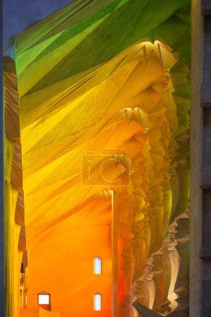 Barcelona, Spain - March 27, 2018: Beautiful light from the sained glass windows in the Basilica Temple Expiatori de la Sagrada Familia or Basilica and Expiatory Church of the Holy Family in Barcelona, Spain.