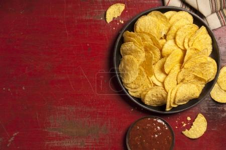 Photo for Mexican nachos chips with salsa sauce on rustic background. Mexican food concept - Royalty Free Image